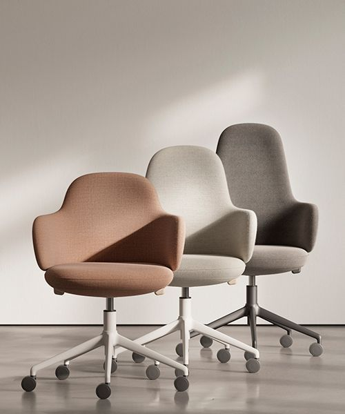 alki lan chair holds self-adjusting mechanisms within clean curving form